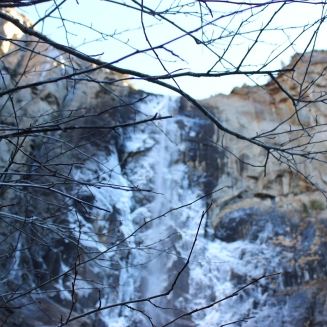 The waterfall, a popular one in Yosemite, is covered in ice, which frequently came crashing down in chunks at a time.