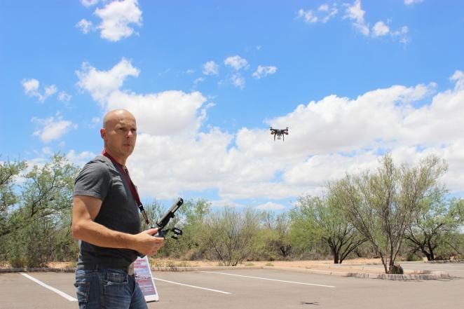 John Malozsak, a real estate agent, flies one of his drones in the desert near Sahuarita.